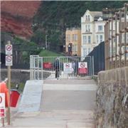 Ignorant cyclist, Dawlish sea wall after new signs and barrier go up!