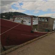 Old knackered fishing boat moored behind Leander Court, Teignmouth