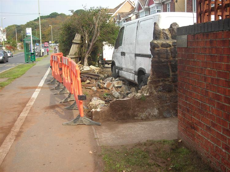 Car ploughs through wall Exeter Road Daw